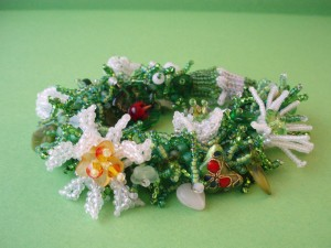photo of Spring Garden fringe bracelet using green seed beads as leafy fringe and white seed beads of beaded flowers by Amanda Crago of Bowerbird Jewellery