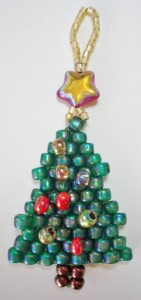 beaded green christmas tree with a red star bead on the top, made by Amanda Crago of Bowerbird Jewellery